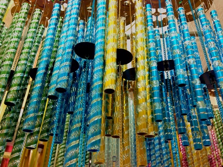 chimes: Colorful wind chimes hanging in a shop