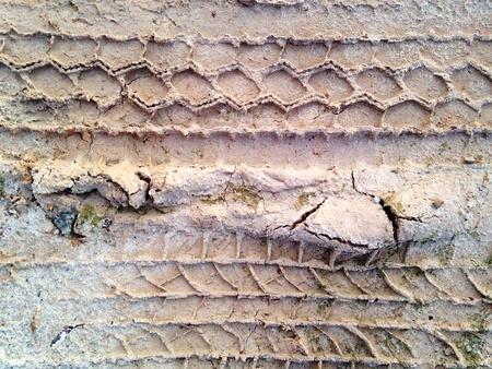 muddy tracks: Tyre Tracks on Muddy Sand Texture