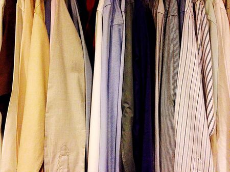 wear: Mens Formal Business Shirts Hanging in a Wardrobe