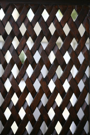 wooden partition: Diamond Pattern on Wooden Partition Surface Stock Photo