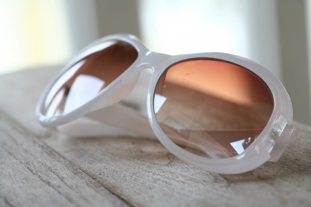 sunnies: Stylish White Sunglasses on a Wooden Table Stock Photo