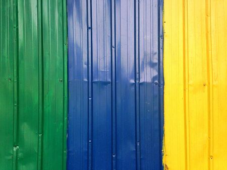 Green Blue and Yellow Painted Fence