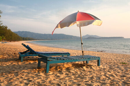 loungers: Empty Beach Loungers and Parasol