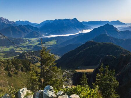 View to the blue sky of the Alps, foggy hazy in the back