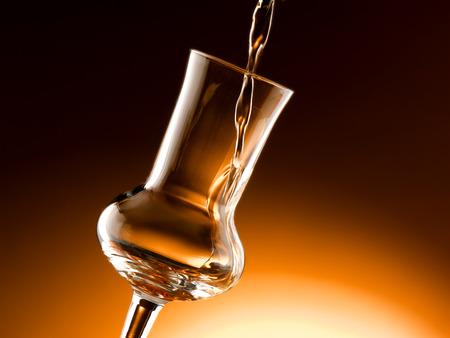 tipsy: Glass of grappa Stock Photo