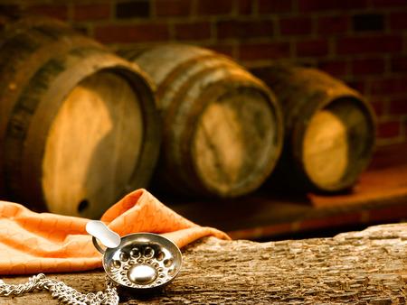 tastevin: wine cellar with wine barrels