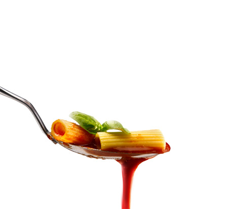 Basil pasta and tomato sauce on an isolated background photo