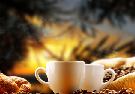 cup of steaming coffee in the early morning photo