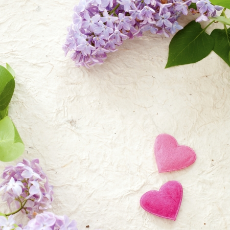 Lilac and hearts on handmade paper photo