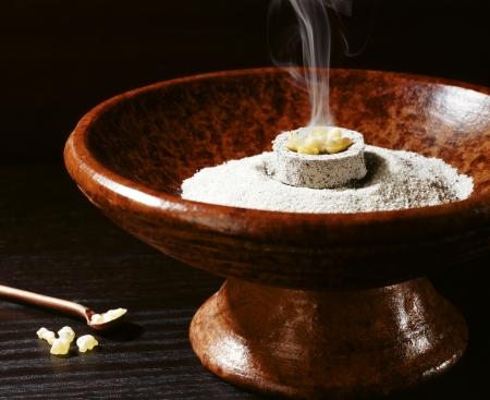 An incense burner burning mastic