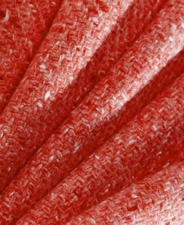 red fabric folded diagonally photo
