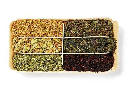 loose herb teas over white photo