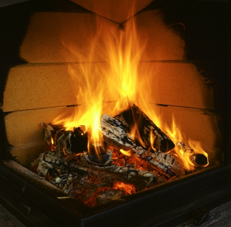 stoking: warming fire in the fireplace