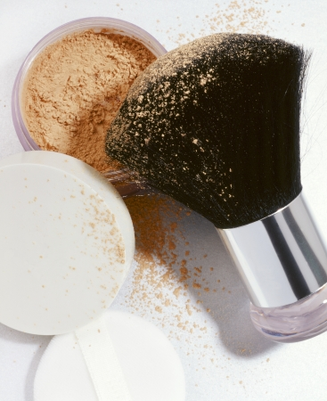 loose face powder with brush and make up puff Stock Photo