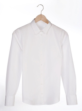 White shirt on a hanger over white background