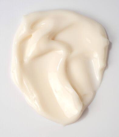 cream isolated over grey background