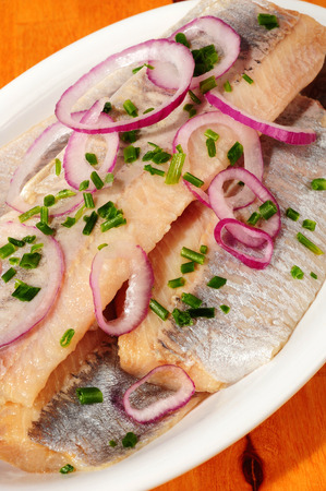 Fresh young herring on white plate