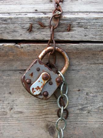 padlock shut off: old rusty padlock in closed position