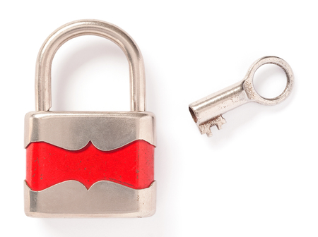 padlock shut off: old padlock and key over white background Stock Photo