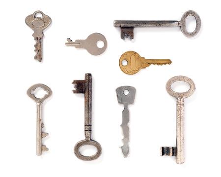 Set of old keys isolated over white background