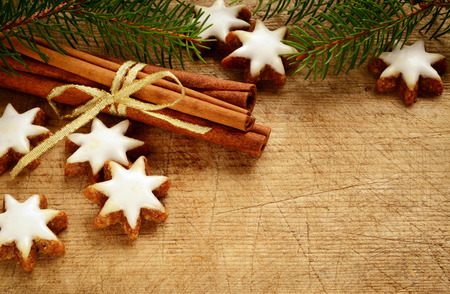 cinnamon stars biscuits over wooden background photo