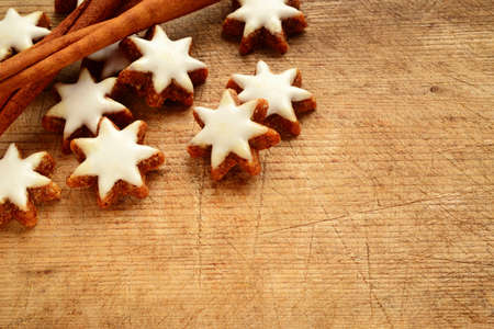 cinnamon stars biscuits over wooden background
