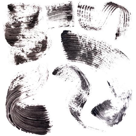 Traces of mascara isolated on white background