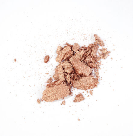 shimmery: metallic brown or golden eyeshadow isolated on white background
