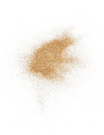 Golden glitter over white background