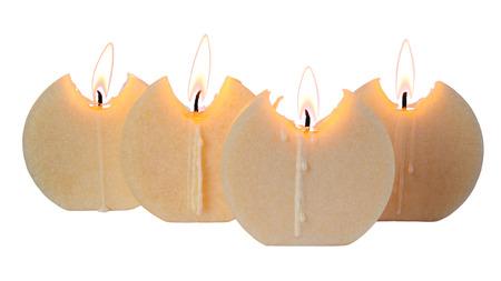 four burning candles isolated over white background Stock Photo
