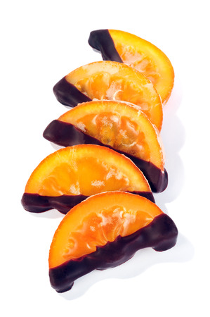 candied orange slices isolated over white background