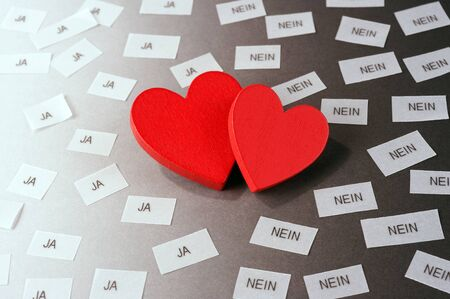 yes no: two red hearts, \ja\, \nein\ (yes, no in english) Stock Photo
