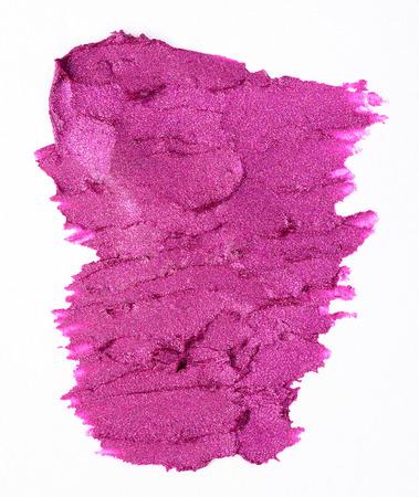 gamme de produit: rose tache de rouge à lèvres sur fond blanc Banque d'images