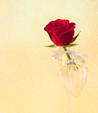One red rose and one glass heart