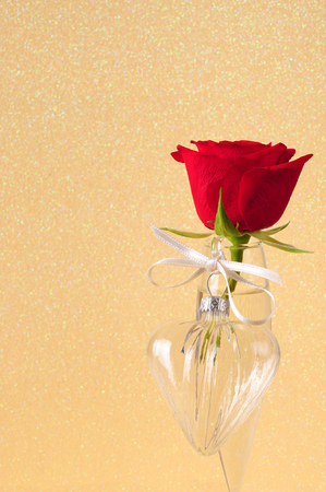 glass heart: one red rose and one glass heart