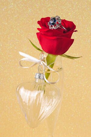 glass heart: red rose, ring and glass heart