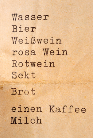 wine  pink: list with drinks in German in typewriter font (englisch translation: water, beer white wine, pink wine, white wine, sparkling wine, bread, one coffee, milk)