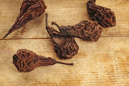Dried pears over wooden background