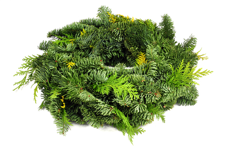green christmas wreath isolated over white background Stock Photo