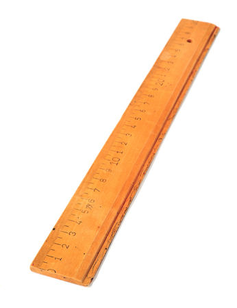 old 30 cm wooden ruler isolated on a white background