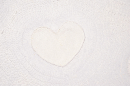 uncoated: white textured paper with heart shape Stock Photo