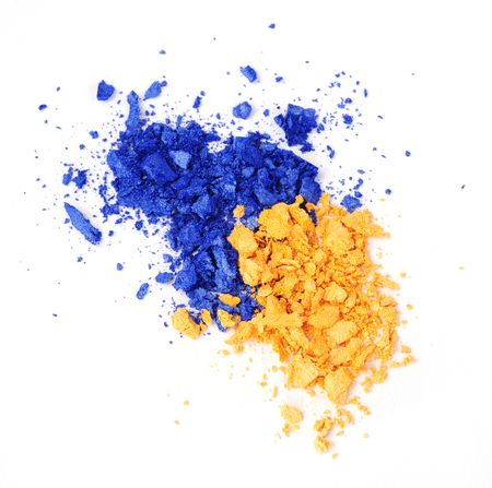 yellow and blue eyeshadow swatch isolated over white background