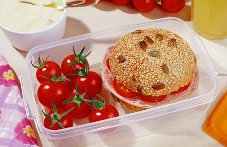 Healthy lunch box with tomatoes