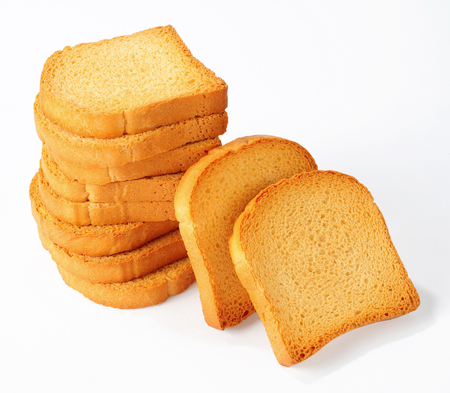 pile of rusks isolated over white background