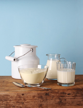Milk powder, glass and  glass jug with milk, milk jug