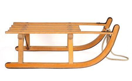 wooden sledge isolated over white background