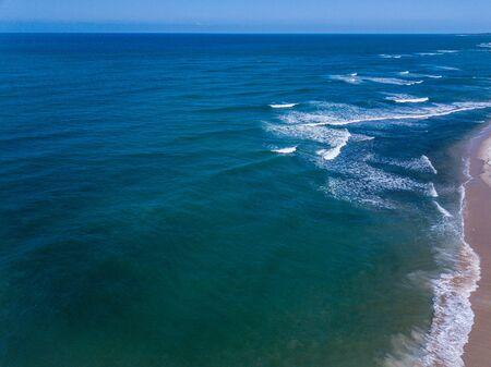 Bird eye perspective of waves hitting the beach on the Swahili coast, Tanzania. Stock Photo