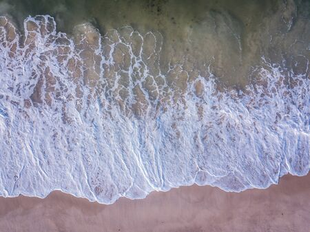 Drone picture of the waves hitting the beach on the Swahili Coast, Tanzania.