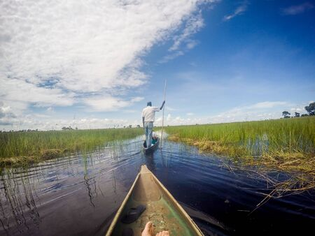 Mokoro canoe trip on the Okavango delta, Botswana.