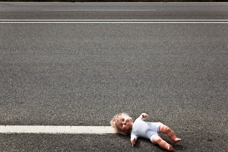 emergency lane: doll leave on a highway lane after car accident Stock Photo